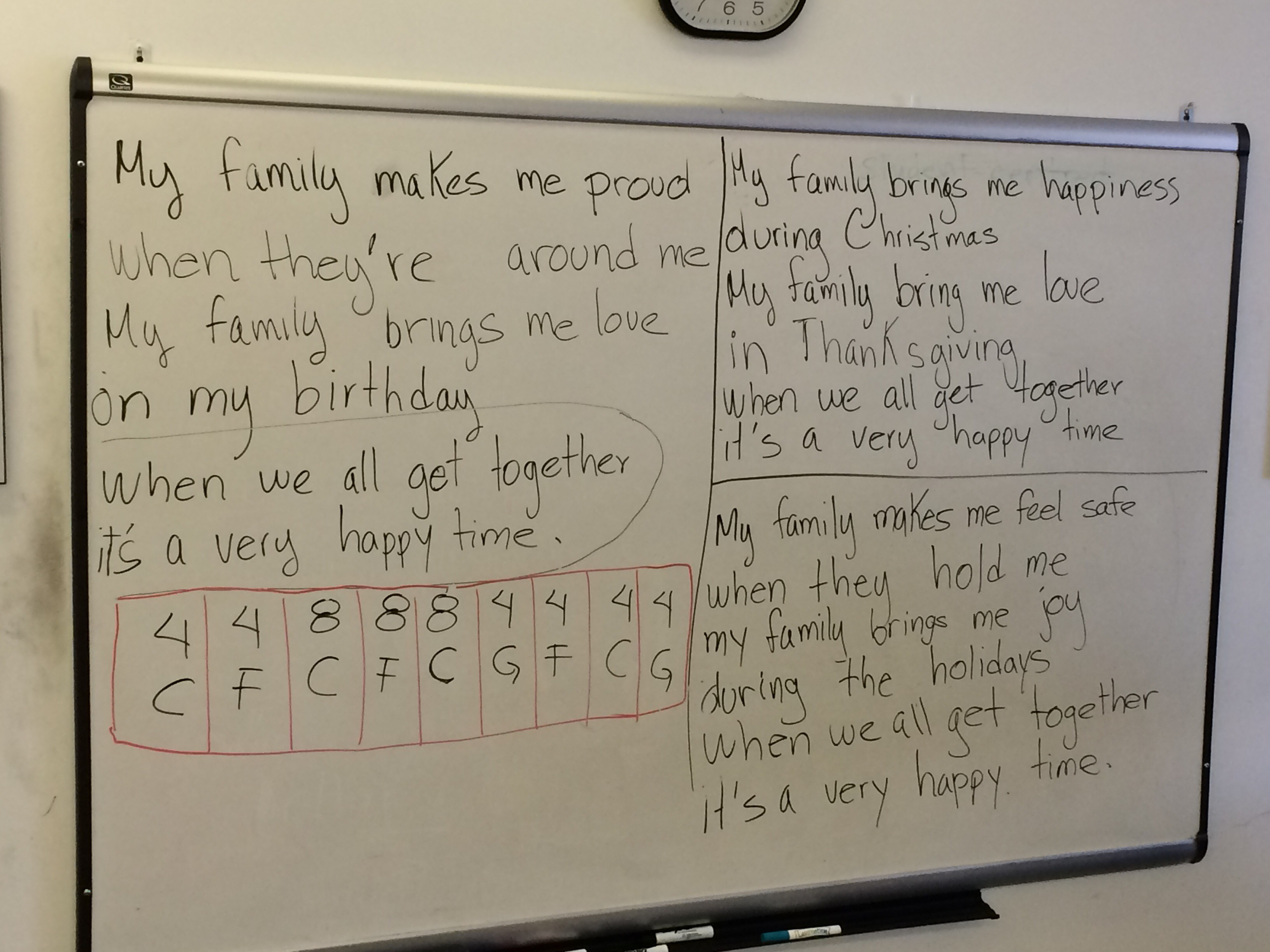photo of the whiteboard showing revised version of kids' first song.