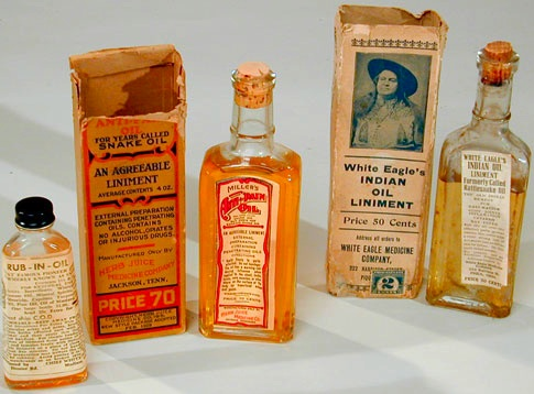 Photo: antique bottles of snakeoil.